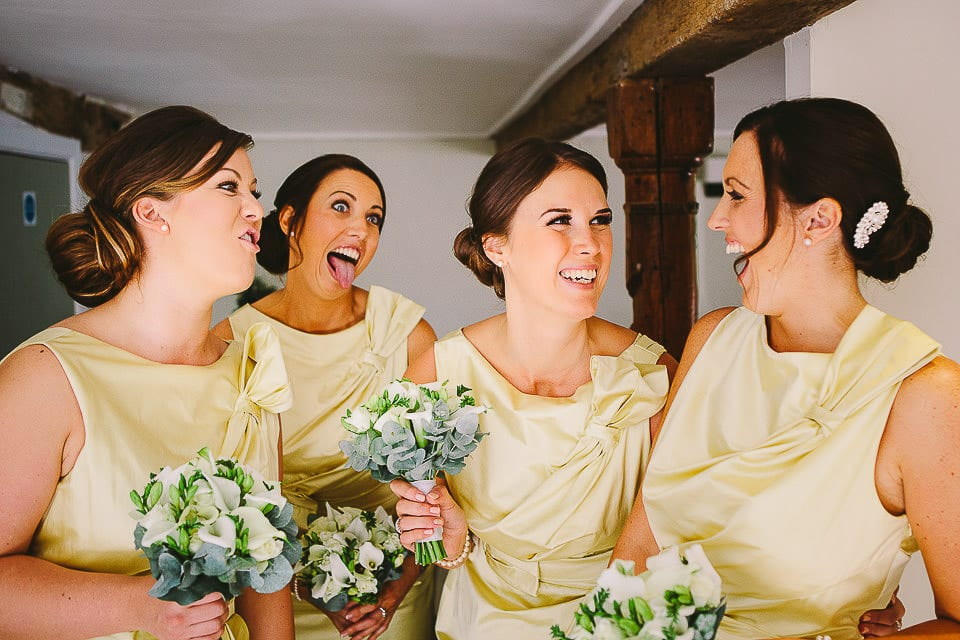 Bridesmaids all pulling faces at Sopley Mill