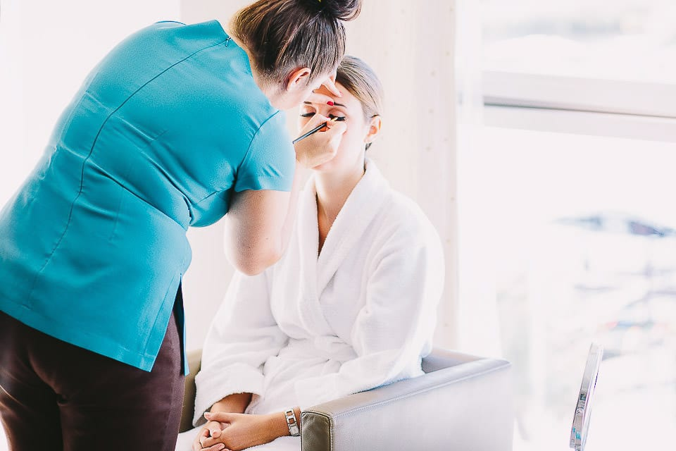 Bridesmaid having her make up applied at The Captains Club Hotel