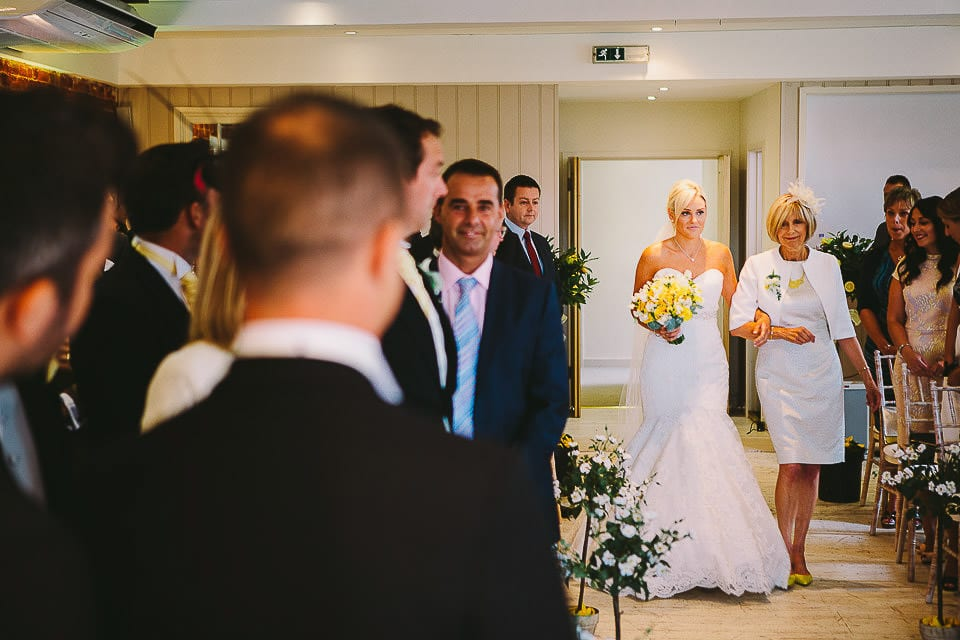 Bride and her Mother walking up the aisle at Sopley Mill