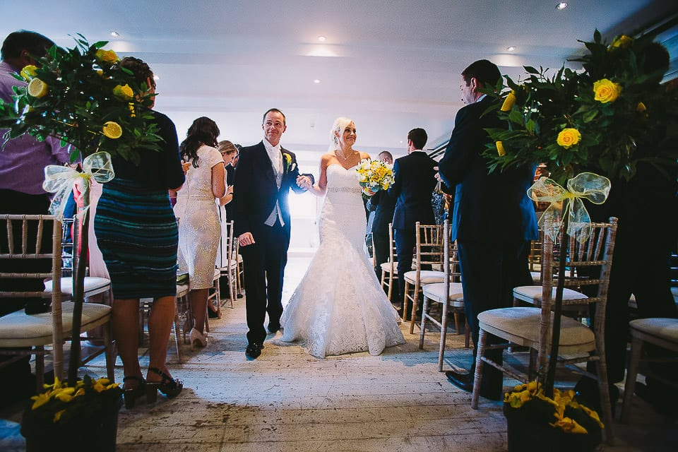 Bride and groom walk down the aisle after the ceremony at Sopley Mill