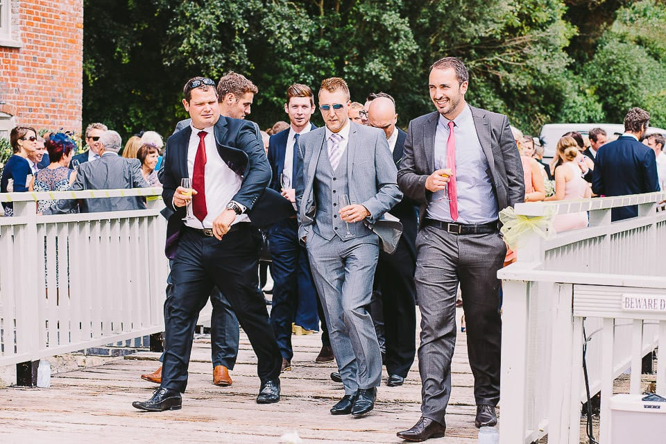 Guests walking to the gardens after the wedding at Sopley Mill