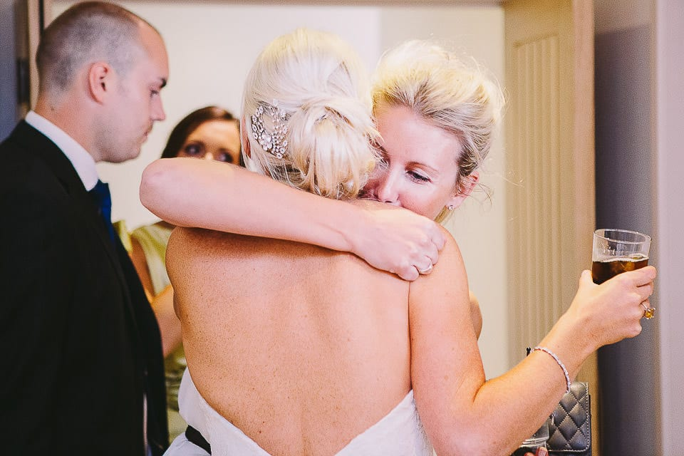 Bride hugging guest at receiving line at Sopley Mill