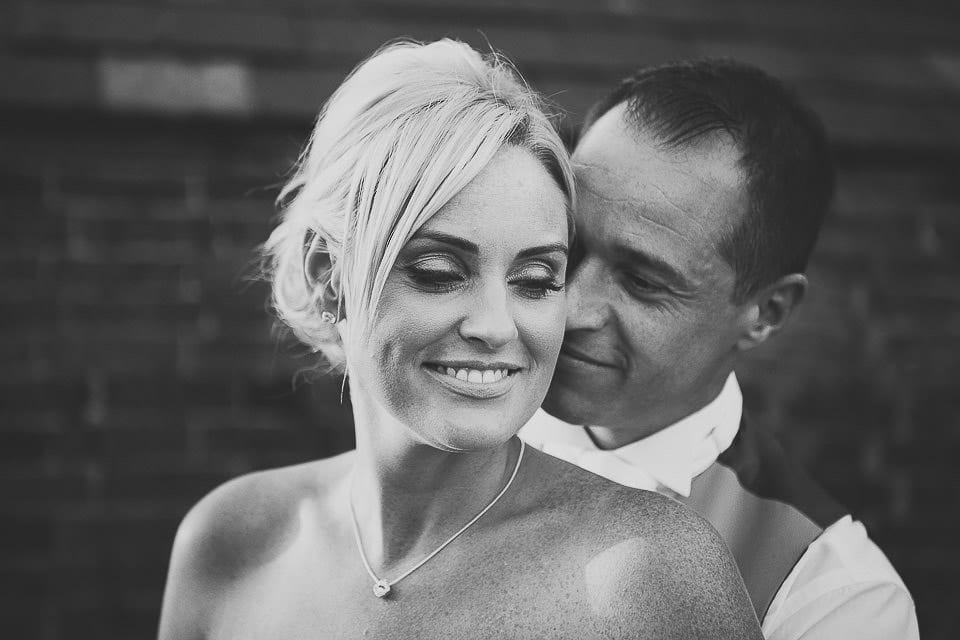 Black and white portrait of the bride and groom in the garden at Sopley Mill