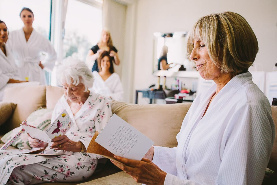 Mother of the bride opening a card from the bride at The Captains Club Hotel