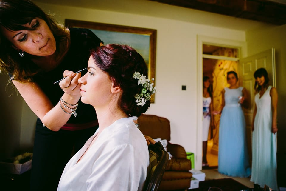 Bride having her makeup finished