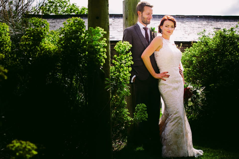 Full length shot of bride and groom in gardens