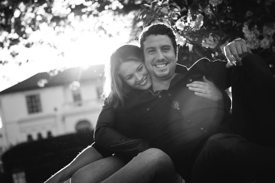 Black and white image of couple sitting on the grass at Pittville Park Cheltenham