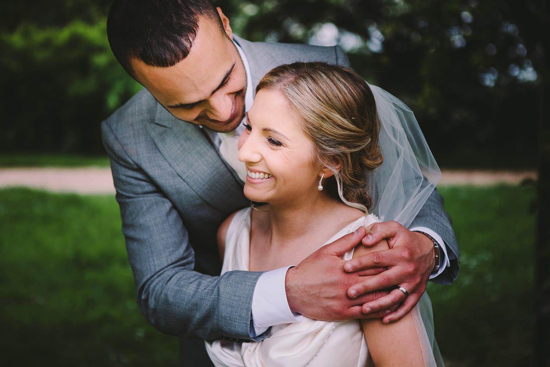 A groom hugs his bride