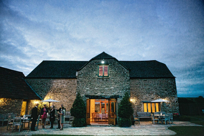 Kingscote barn at night