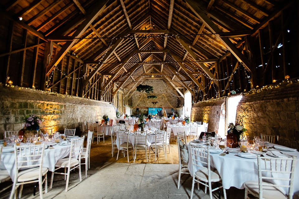 Interior image of barn laid out for wedding breakfast