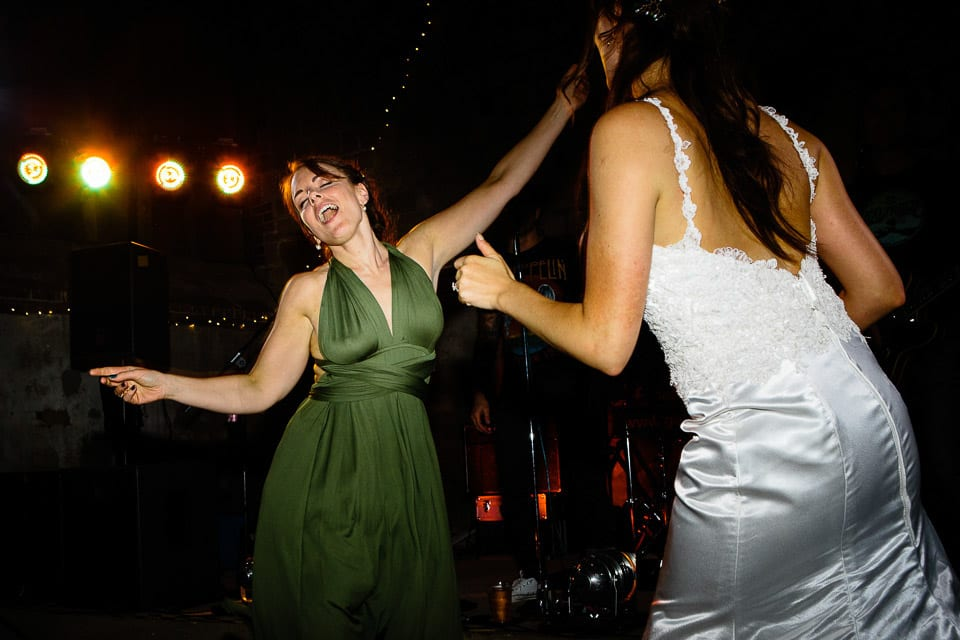 Bride dancing with her bridesmaid