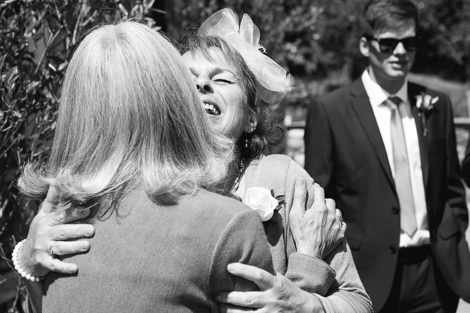 Black and white image of brides mother greeting a guest