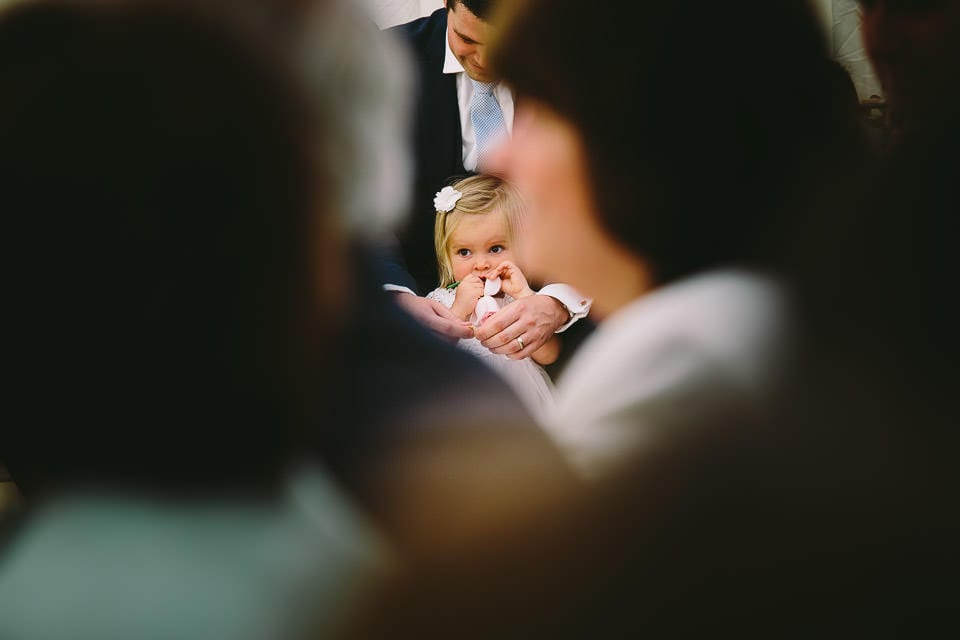 Flower girl through the crowd during ceremony