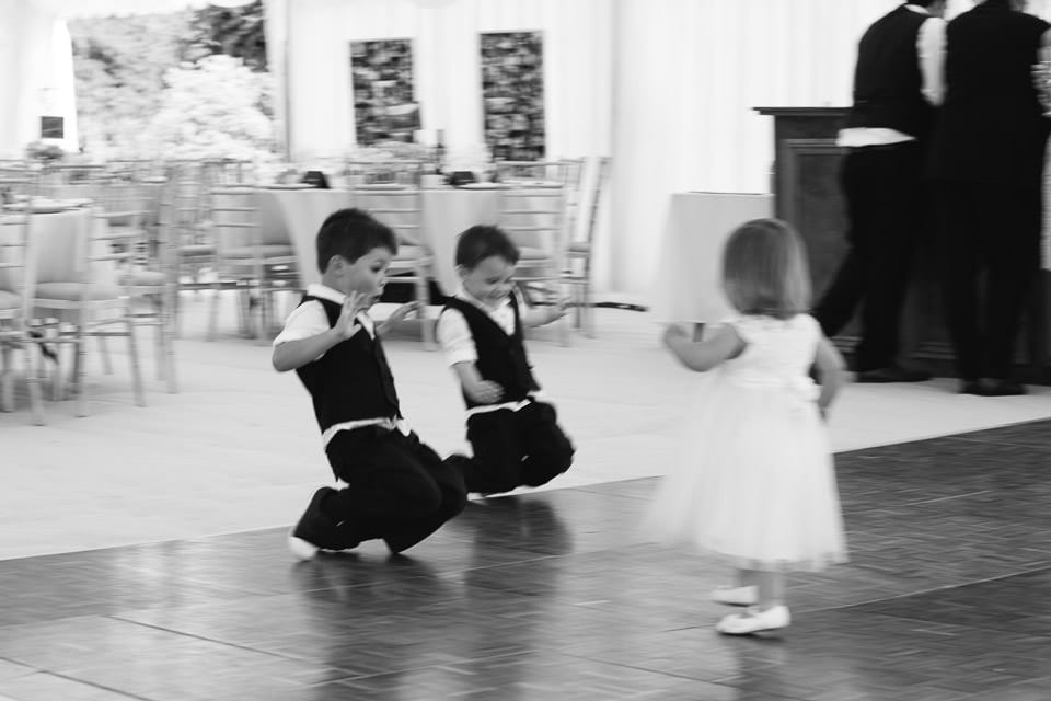 Black and white image of children playing on the dancefloor