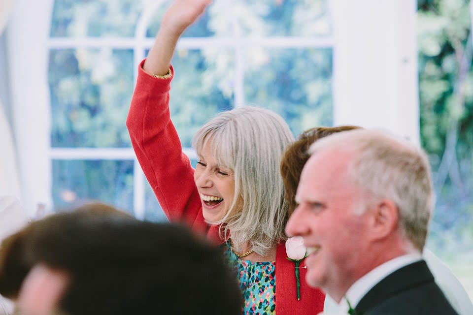 Brides mother waving during speeches