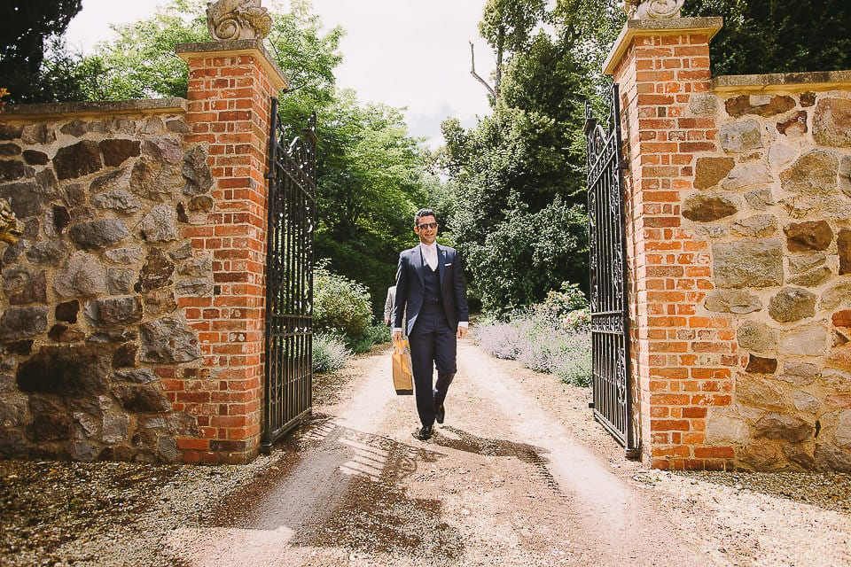 Groom walking down the drive