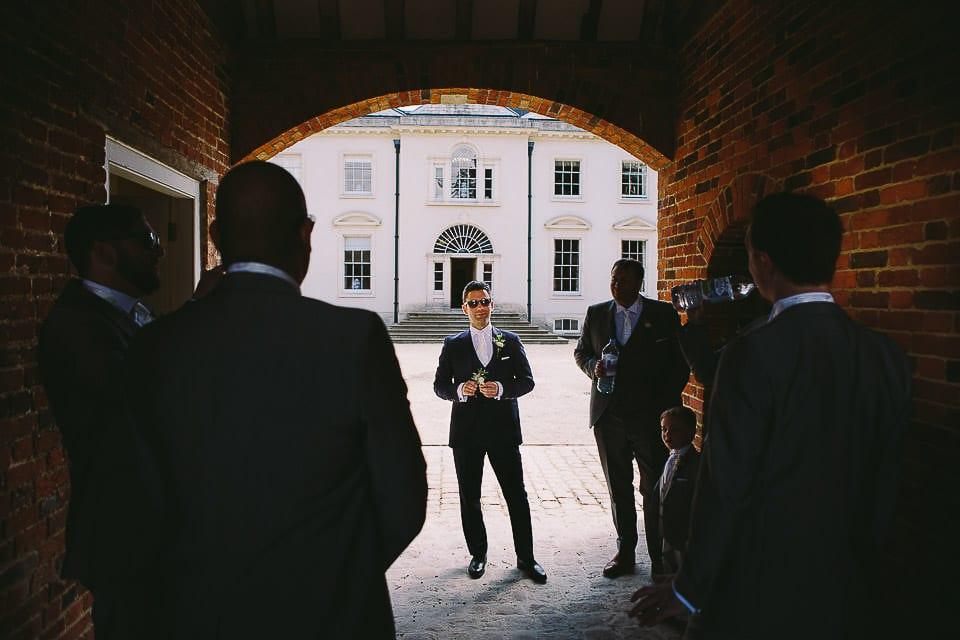 Groom and his groomsmen waiting in courtyard