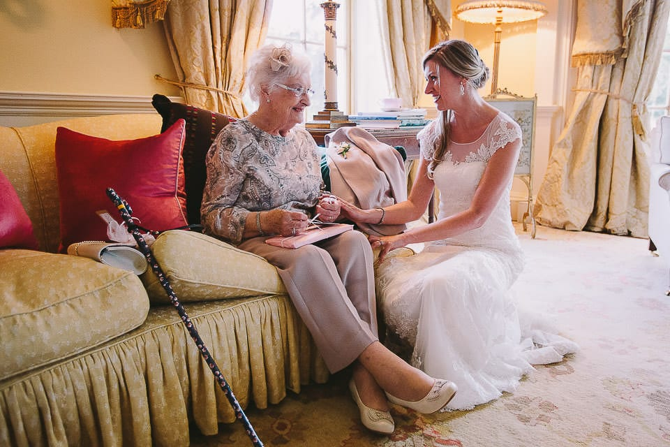 Bride with her grandmother sitting in lounge