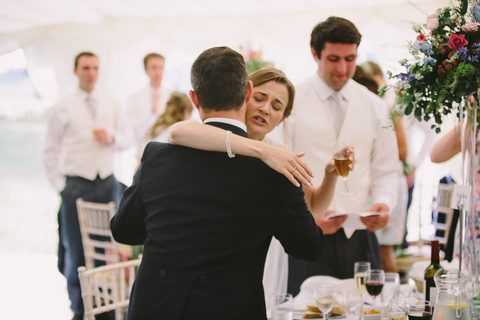Bride hugging her brother after his speech