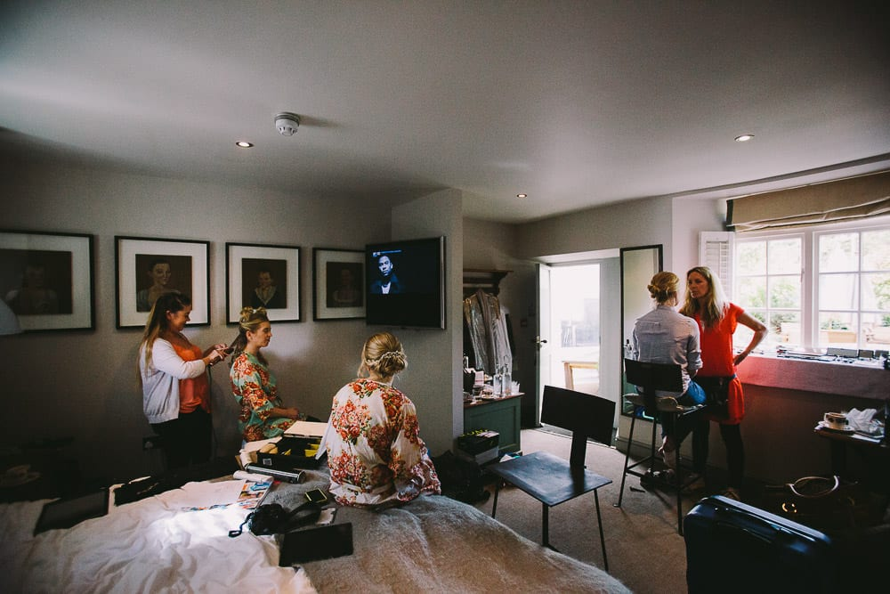 Bride and bridesmaids getting ready in hotel room at The Wheatsheaf Inn