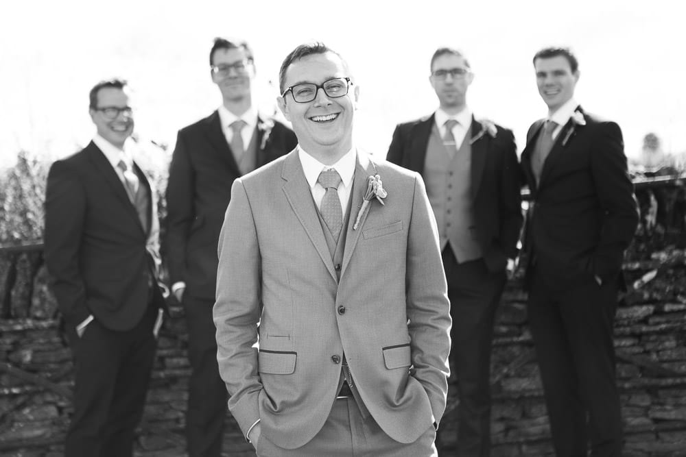 Groom and his groomsmen in the gardens of Cripps Stone Barn