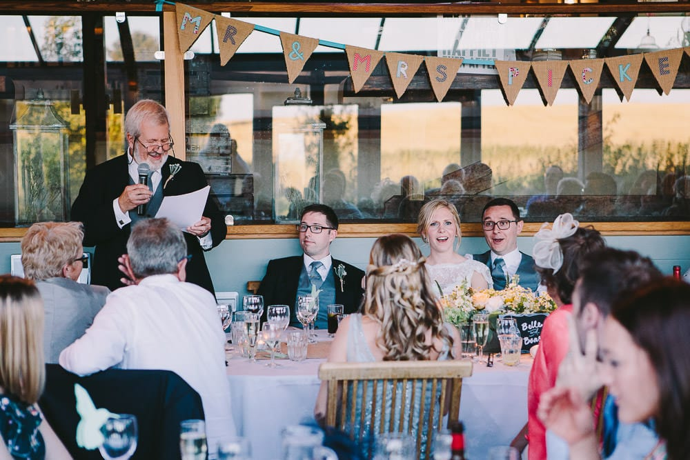 Father of the bride gives his speech in the Dutch barn at Cripps Stone Barn