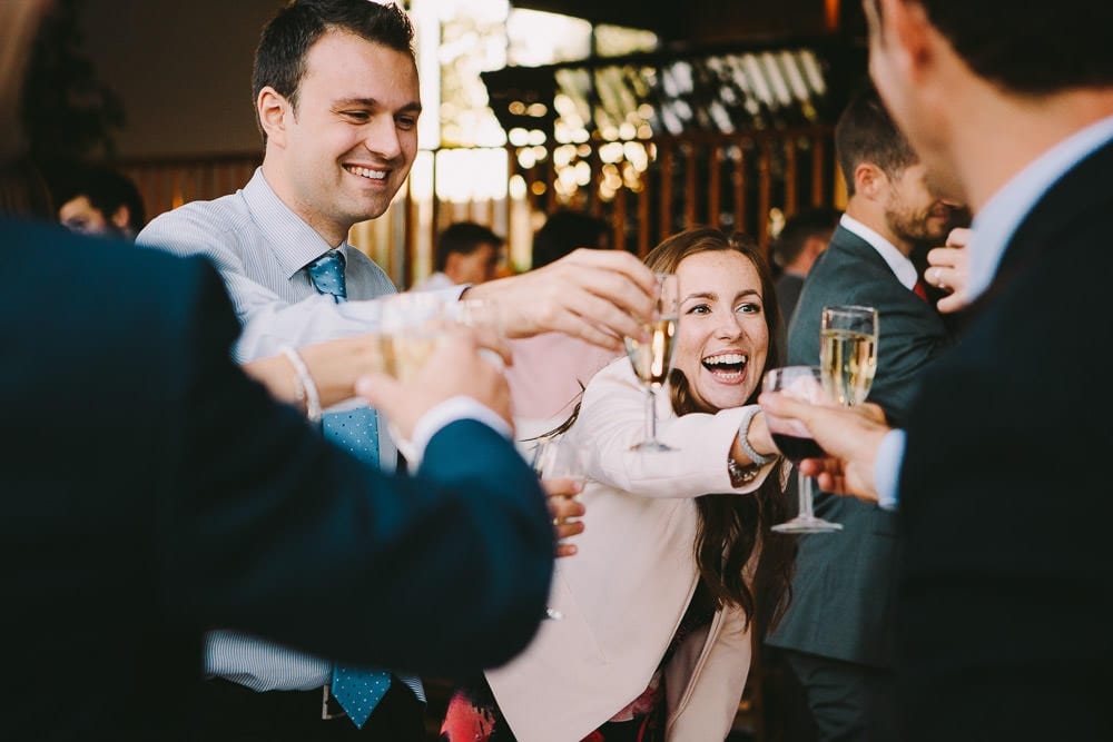 Guests toasting the bride and groom at Cripps Stone Barn