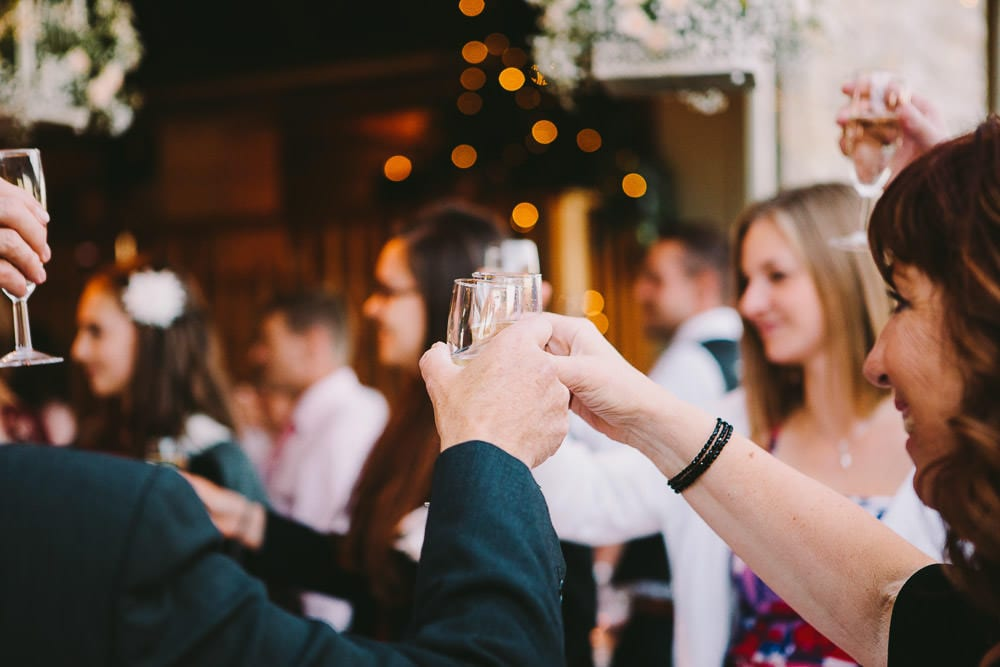 Guests raising a glass at Cripps Stone Barn
