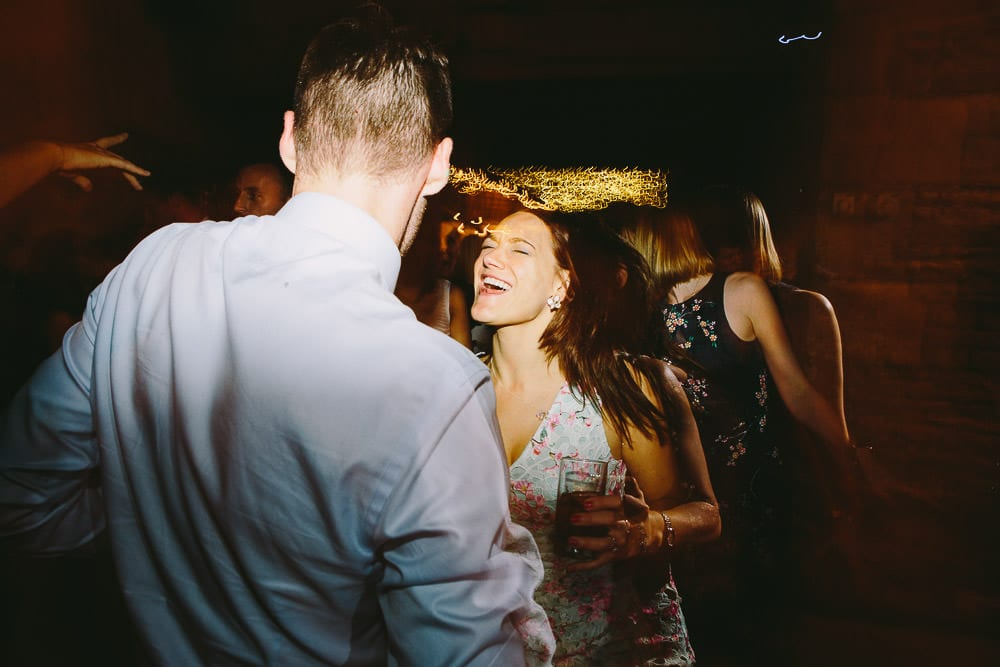 Guests dancing on the dance floor at Cripps Stone Barn