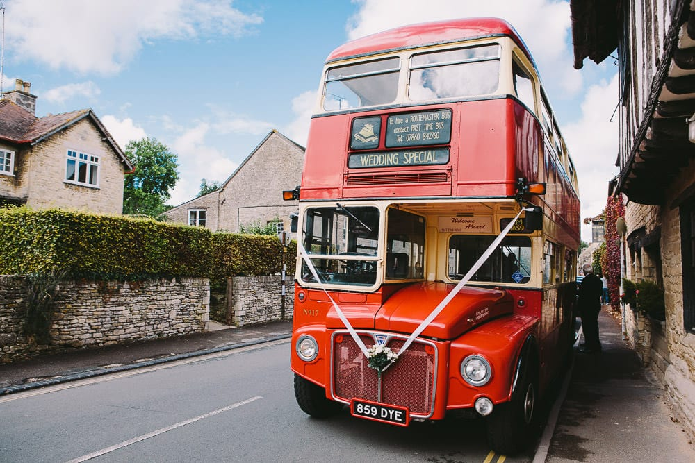 Vintage routemaster bus waiting outside The Wheatsheaf Inn to take guests to Stone Barn