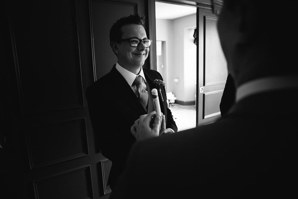 Groomsman giving a cigar to the groom at The Wheatsheaf Inn