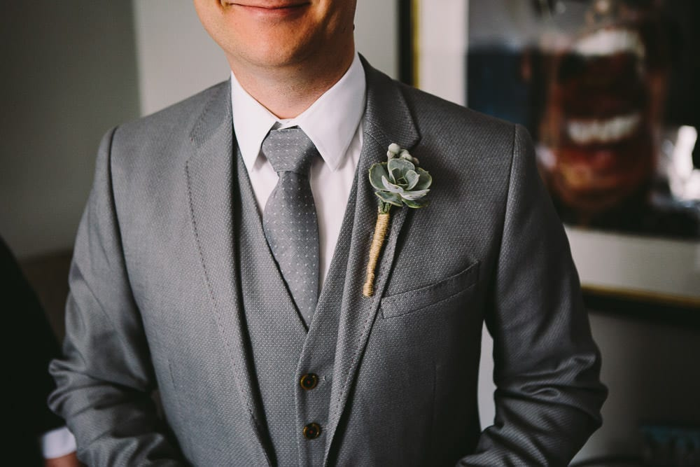 Close up view of the grooms buttonhole at The Wheatsheaf Inn