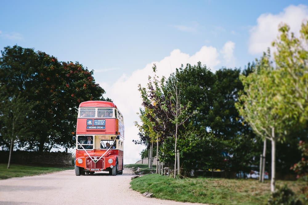 Vintage routemaster bus coming down the driveway at Cripps Stone Barn