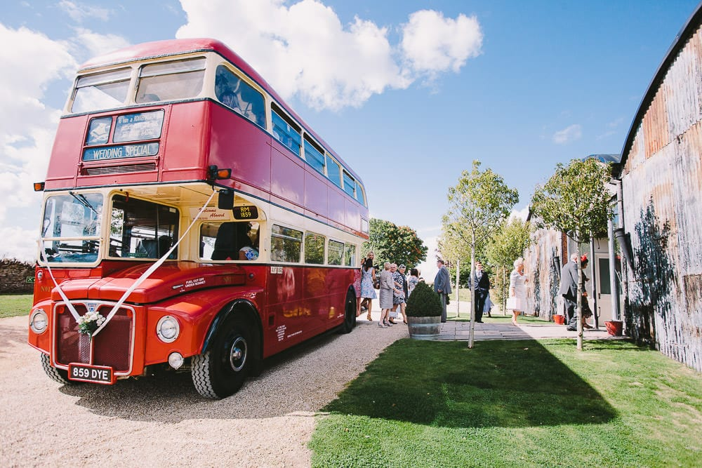 Guests disembarking the vintage bus at Cripps Stone Barn