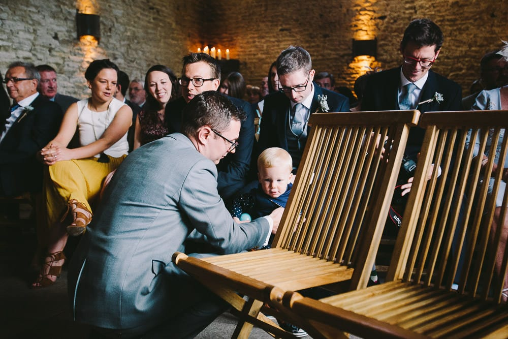 Groom playing with his nephew before the ceremony at Cripps Stone Barn