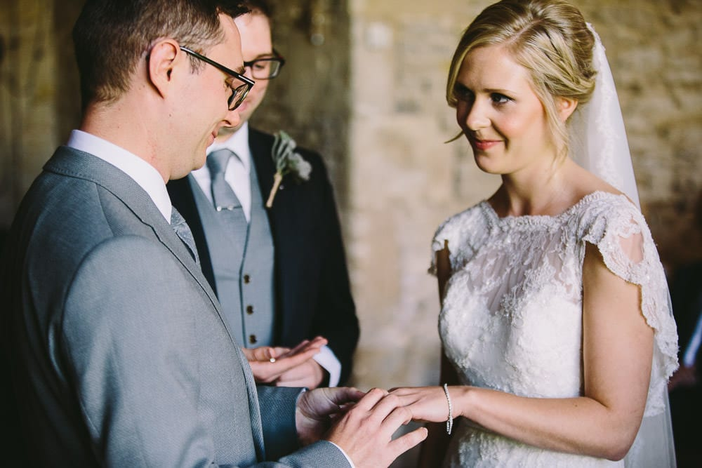 Bride and groom exchanging rings during ceremony at http://www.amazon.co.uk/The-8-Week-Blood-Sugar-Diet/dp/1780722400