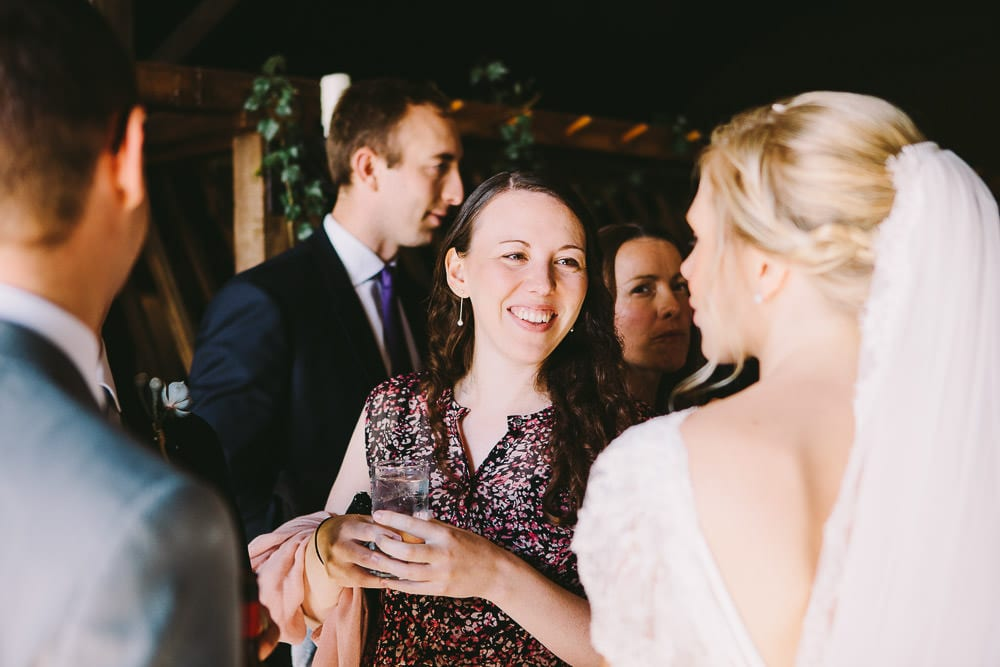 Guests congratulating bride after the wedding at Cripps Stone Barn