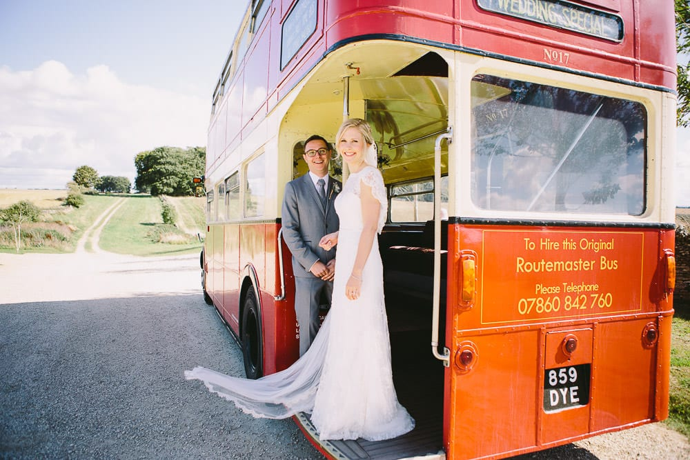 Bride and groom on the vintage routemaster bus at Cripps Stone Barn