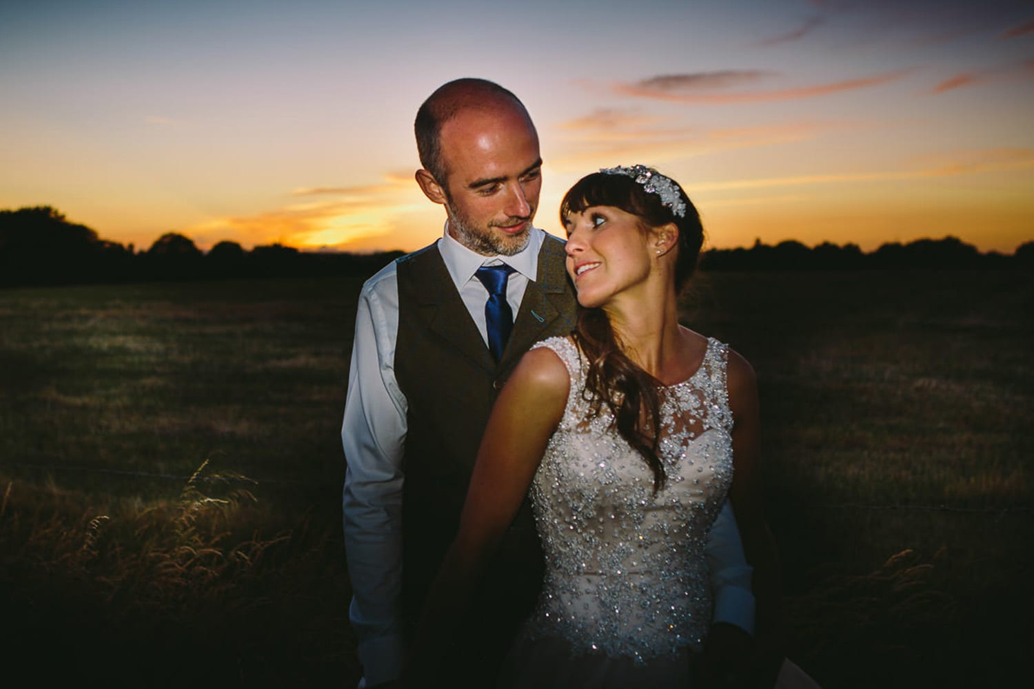 A portrait of the bride and groom at sunset