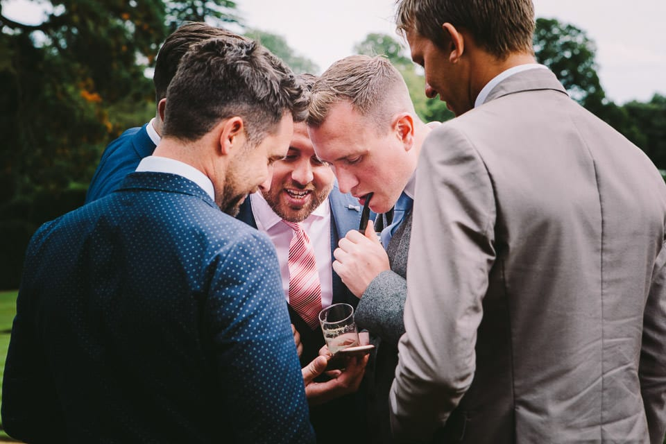 Group of male guests checking phone