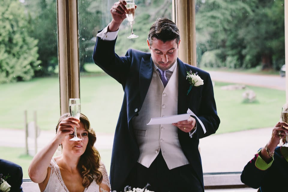 Groom raising a toast during speech