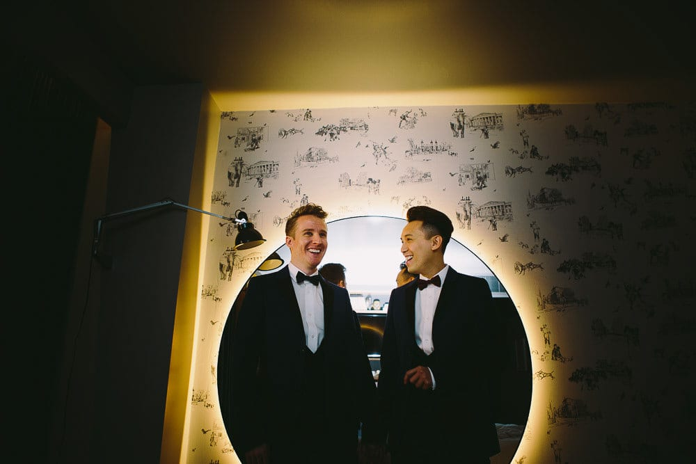Grooms enjoying a joke before setting off for their wedding