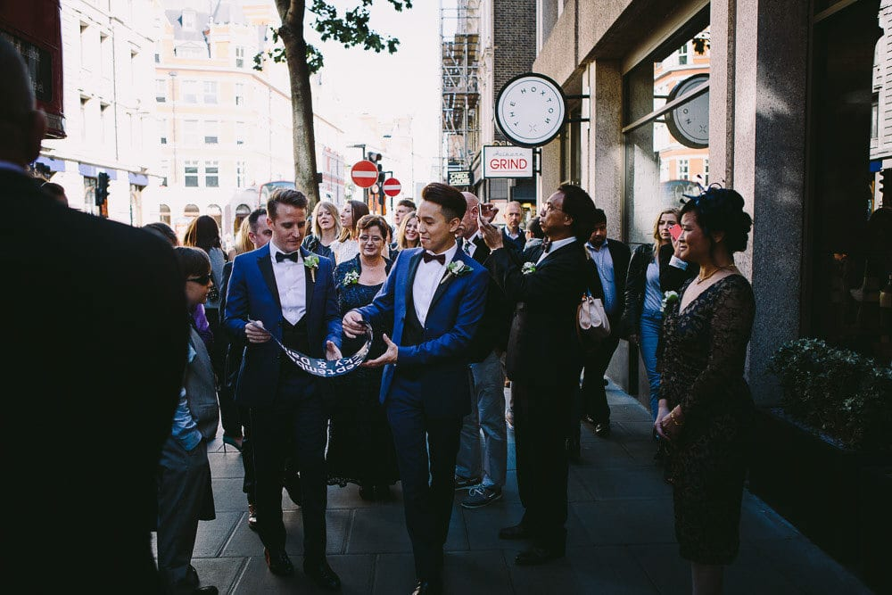 Grooms and their wedding party outside The Hoxton London