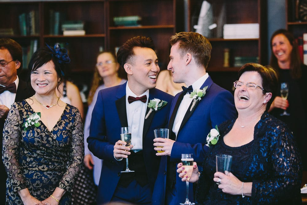 Grooms laughing at the speeches in The Hoxton London