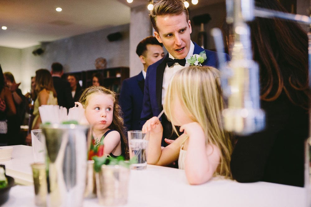 Groom talking to some very young guests in The Hoxton London