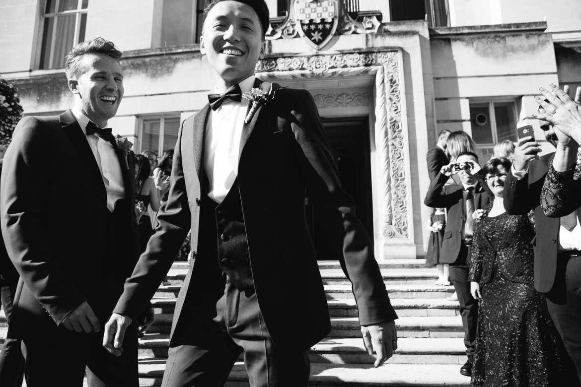 Black and white image of couple leaving the town hall