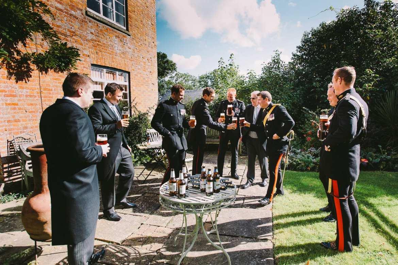 Groom and groomsmen in military uniform