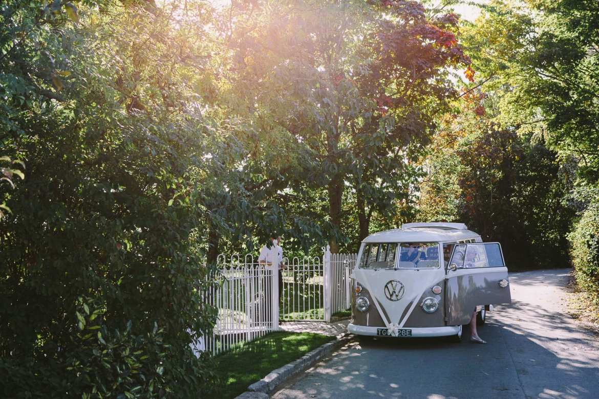Couple arriving at reception in VW Camper