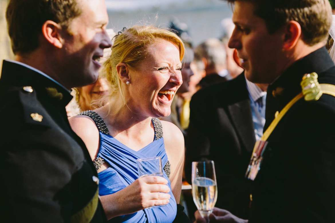 Guests having a laugh at afternoon reception