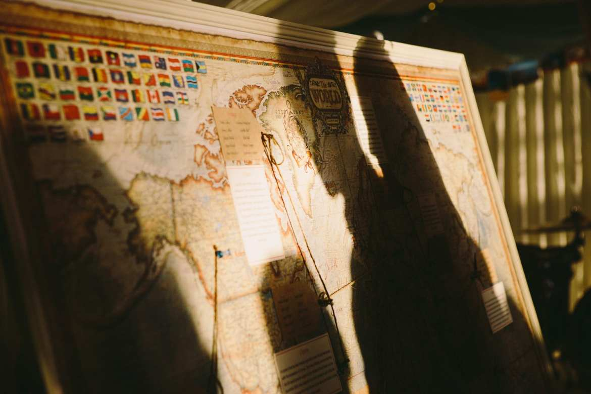 Image of table plan pinned on a map of the world